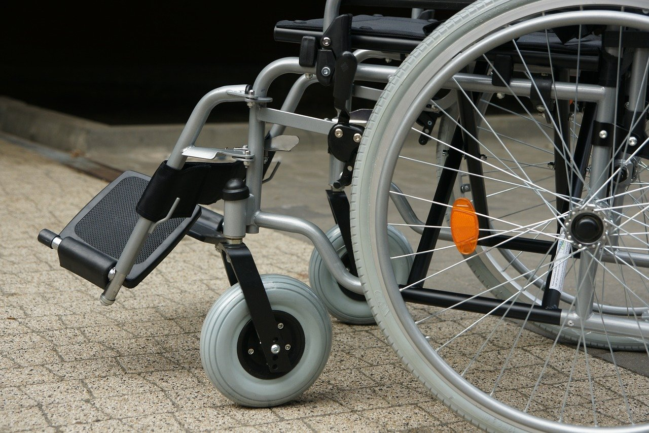 A close up image of wheelchair wheels